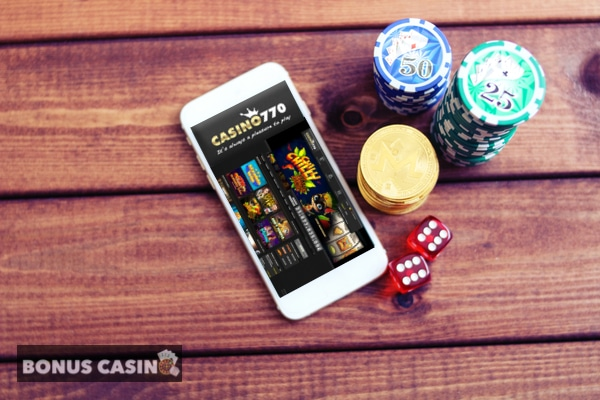 casino770 sur smarthphone avec jetons et dés de jeu, logo bonuscasino